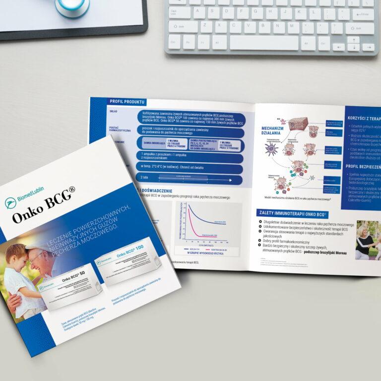 Broszury reklamowe firmy Biomed Lublin, z których jedna jest otwarta, a druga prezentuje okładkę