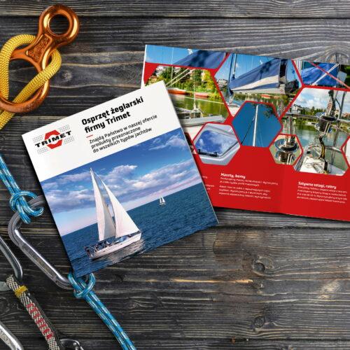 Prezentacja projektów folderów reklamowych firmy Trimet, działającej w branży żeglarskiej