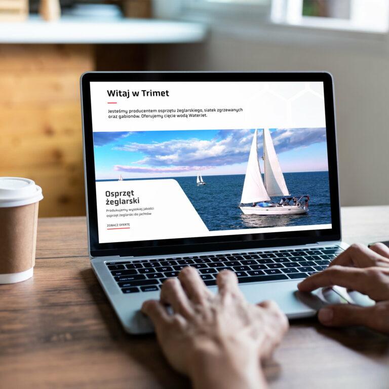 Strona www firmy Trimet wyświetlona na laptopie