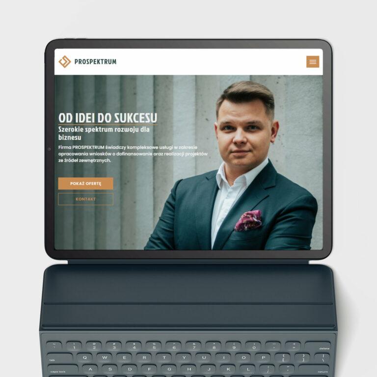 Projekt strony internetowej realizatora projektów ze środków zewnętrznych #prospektrum widoczna na laptopie